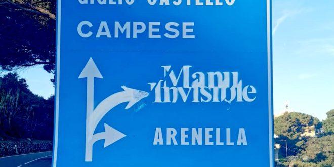 cartello manu invisible isola del giglio giglionews